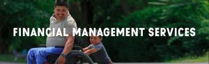 "Header image that says, ""Financial Management Services""; happy boy pushing father who is in a wheelchair"